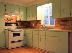 Todays Project: Reclaimed wood kitchen backsplash, made from old pallets.