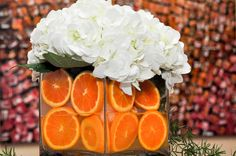 Using fresh oranges in your centerpiece is a unique way to incorporate the color orange or a fun citrus theme!