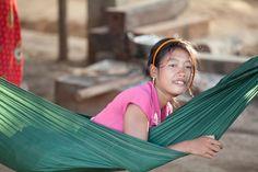 Girl in a hammock, Som village, Cambodia (photo by Anna Willett)