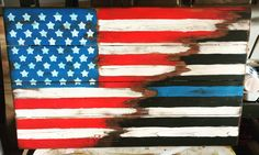 A personal favorite from my Etsy shop https://www.etsy.com/listing/466977867/wooden-21x36-usathin-blue-line-flag
