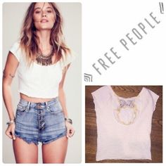 Free people eyelet crop top Free people eyelet crop top with lace flower cut out in back. Great condition no flaws. Super cute for summer Free People Tops