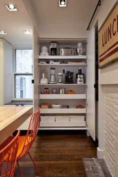 A closet-like space can be a good home to all of your small appliances.  have enough outlets that you can leave the appliances on roll out shelves in the closet