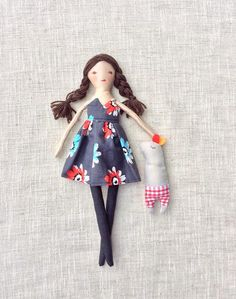 Tania is a dress-up cloth doll made for active, quiet and imaginative play for children of all ages. Made in a pet free, smoke free environment, she is approximately 13 inches (33cm) tall. The clothes are closed with Velcro making them easy to put on and take off. . The body may be cleaned