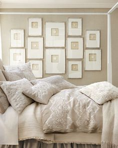 Pretty white room. Love the wall color and frames