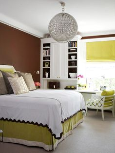 Create Drama  Add drama with contrasts. In this chic bedroom, drama is created through size and color.  The eye is immediately drawn to the hanging globe fixture. The large size creates instant drama. And the contrast between the rich chocolate-brown walls and white trim and bedspread is made extra striking when paired with a splash of lime green.