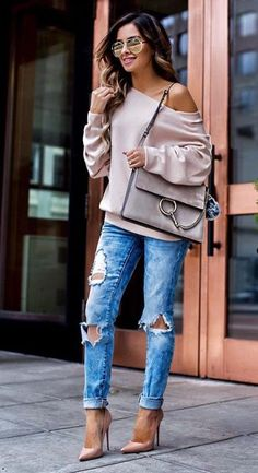Cuffed jeans, heels, baggy if the shoulder sweat shirt.