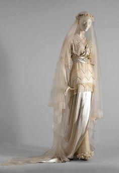 1913-1914 Wedding dress; silk satin, embroidered net, silk chiffon, lace ribbon, silk ribbon, imitation pearls, wax orange blossom flowers, silk tulle, jap silk, silk organza