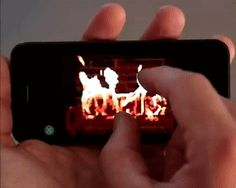 Animated gif. phone, fire, pullover