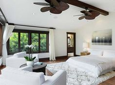 The ceiling fans exude a tropical feel while dark panelling adds warmth to the mostly white space.