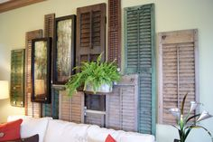nest full of eggs: summer 11 ideas house salvaged shutters as wall decor Shutter Wall, Shutter Doors, Old Shutters, Interior Shutters, Bedroom Shutters, Bedroom Nook, Window Shutters, Old Doors, Handmade Home Decor