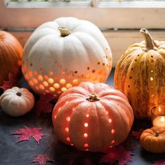 Carved Pumpkins for Lanterns - 12 DIY ideas for decorating your home this Halloween on HOUSE - design, food and travel by House & Garden.
