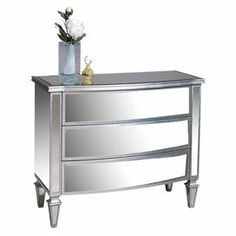 "Mirrored wood chest with silver-finished trim and 3 drawers.     Product: ChestConstruction Material: Wood and mirrored glassColor: SilverFeatures:  Silver leaf detailThree drawers Dimensions: 34"" H x 43"" W x 20"" D"