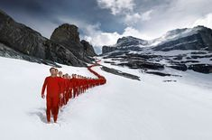 Swiss sports company Mammut tests the endurance of their clothing and equipment on climbers and skiers each year, and photographer Robert Bösch has captured amazing shots of those group trips up the Alps. There is conceptual planning in all of these photos, as no one would be bare foot in the snow if not for.... http://illusion.scene360.com/art/68693/beautiful-photos-of-mountaineers-in-the-alps/
