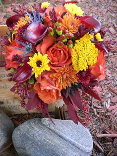 Lots of texture for this fall brides bouquet.   www.floraldesignsbyjodi.com