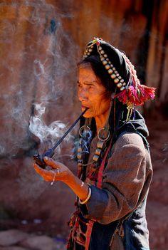 North Vietnam Minorities-old lady smoking pipe