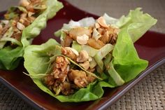 Sweet & Spicy Chicken Lettuce Wraps by recipegirl: Lightly spiced, sweet and crunchy. So pretty and delicious in tender Bibb/Butter lettuce leaves! #Chicken #Chicken_Lettuce_Wraps #recipegirl