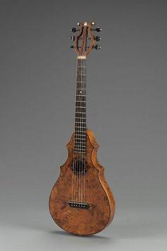 Shield-shaped guitar (Wappengitarre)    Victorin Drassegg, about 1835  Length 97.2 cm, width 31 cm (Length 38 1/4 in., width 12 3/16 in.)  Walnut, spruce, ebony, ivory, cow bone, mother-of-pearl, sheep gut, copper