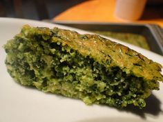 Savory Spinach cake.  Estimated nutrition facts per piece of cake (if you cut the cake in 4 big pieces): 238 kcal, 12.75 g of protein, 26 g of carbs, 0.75 g of sugar, 9.5 g of fat