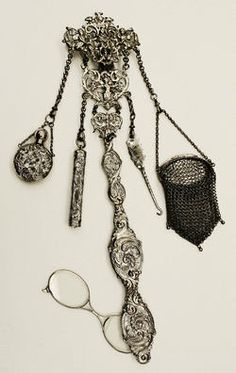 Chatelaine: In the 18th and 19th centuries, women in charge of their estates wore a decorative clip about the waist,of long chains holding useful notions within reach.