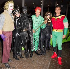 Party time: The group outside the club, along with another guest dressed as The Joker