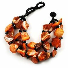 Multistrand Shell-Composite Beaded Bracelet (Black & Orange) Avalaya. $14.40. Occasion: anniversary, club night out, cocktail party. Material: sea shell, glass. Fastening: button and loop. Type: multi-strand, chunky. Wear On: wrist