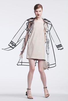 Wanda Nylon's polyurethane trench and Yves Salomon's suede dress. Boyy bag; Lanvin sandals.