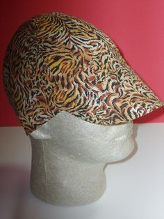 Virtual Cyber Rags Tiger's Skin Welding Hat. This welder's cap can be lined or unlined with an optional terry lined band with a long or short bill. Made from 100% cotton that is machine washable, tumble dry, or hang dry.
