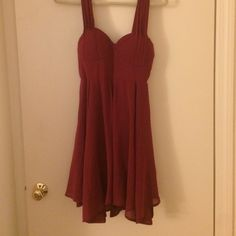 Burgundy fit and flare dress - Large Brand is Stella (bought off Tobi) size large. Zipper back with some stretch to it. Super cute on and very open back. Small rip on back strap that isn't noticeable and probably easily fixable. Priced to sell so make a deal!! Tobi Dresses Prom