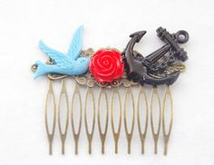 This rockabilly nautical hair comb was handmade with love using a filigree antiqued brass hair comb, and features a red resin rose between a