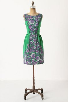Anthropologie's Conspicuous Shell Dress combines the classic 60s hourglass shape and bright fun prints.