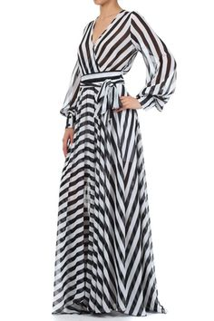 Our popular striped maxi is back and better than ever! This beautiful graphic striped maxi dress - a standout style from the runway , this dress will be your ultimate statement piece for spring.