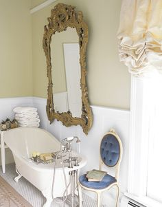 Claw-foot bathtub and gilded mirror- yes please!