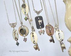 A lineup of typewriter keys, watch faces, skeleton keys, keyholes, beads, and rhinestones.