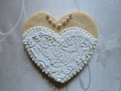 Heart shaped wedding dress bodice hand-decorated sugar cookie by CreativeChaosinCT on Etsy, $72.00