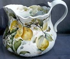 Celee Evans~Porcelain~A Fancy lemonade pitcher~Circa 2001