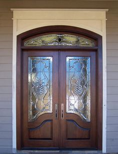 "This lovely pair of Custom Mahogany Doors are X with an ""S"" shaped lock rail. They are hung in a Mahogany Jamb with a Segment Top Transom. The glass is Leaded Beveled and Textured Glass. The texture in the background glass gives complete privacy. Double Front Entry Doors, Double Doors Exterior, Wood Entry Doors, Modern Front Door, Entrance Doors, Pine Doors, Patio Doors, Barn Doors, Front Door Design Wood"