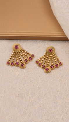 Vibrant stone studded hues on the gold earrings, inspired by Gold Jhumka Earrings, Indian Jewelry Earrings, Jewelry Design Earrings, Gold Earrings Designs, Gold Jewellery Design, Designer Earrings, Necklace Designs, Gold Jewelry, Wedding Jewelry