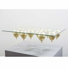 The balloon table gives the appearance of being held up by golden balloons