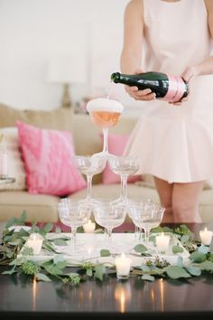 This DIY champagne tower is SO much easier than you might think! And such a fun way to dress up a party, whether it be a Valentine's soiree or a birthday bash. Champagne Tower, Pink Champagne, Champagne Drinks, Champagne Brunch, Champagne Flutes, Loft Studio, Hen Party Favours, Style Me Pretty Living, Bridal Shower Decorations