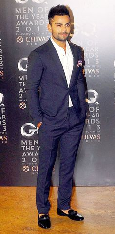 Cricketer Virat Kohli attended the GQ Men of the Year Awards in a navy blue suit. #Fashion #Style