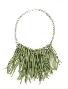 Green handcrafted necklace with silver chain and leather suede fringing detail.