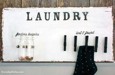This laundry room sign is totally functional! Everyone needs a place for lone socks and loose change.