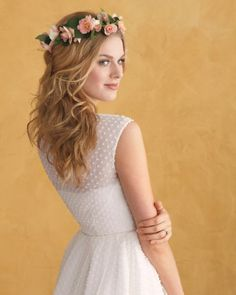 Embrace your inner flower child with this wreath of blush-colored mini roses. Wrap about 15 blooms around floral wire, securing with green tape, then twist the wire ends together to form a circle; anchor in hair with bobby pins.J.Crew dress (#47555)
