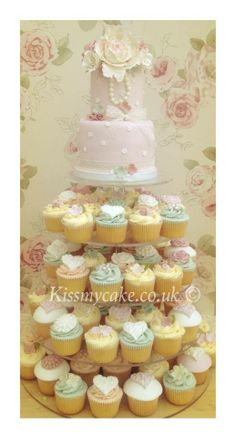 Pretty pink wedding cupcake tower and two tier wedding cake.