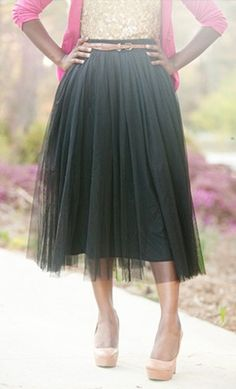 """Banded A-line long skirt with layers of tulle fabric over a solid, fully lined skirt. Has elastic waist for a comfortable fit. Available in colors that you can wear in all seasons! Sizes S to L. 100% Polyester Approx. 31.5"""" from waist to hem."""