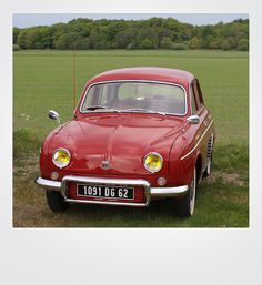 Not sure of the year but mine was red and looked like this.  Renault Dauphine Deluxe  -  had a Push Button transmission.