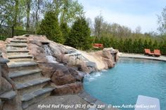 Custom Carved Waterfall and Slide with Bluestone Steps, spillover waterfall, tiled waterslide.