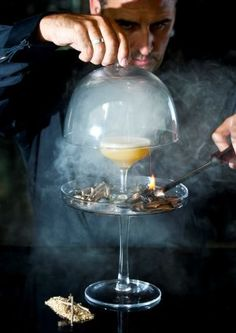 DIY - Old Fashioned Gunpowder Plot. The Gunpowder Plot, which is made with Gunpowder tea infused gin, shaken with fernet branca, spiced gunpowder syrup and dandelion and burdock bitters. It's served straight up in a martini glass encased within a smoking cloche, which also houses a mound of smoking gunpowder twigs and oak scented fog.