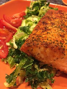 Baked salmon on a bed of raw kale and broccoli salad