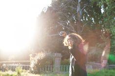 Journalist and writer Jina Khayyer dancing in the sun at Villa Lena, Tuscany.